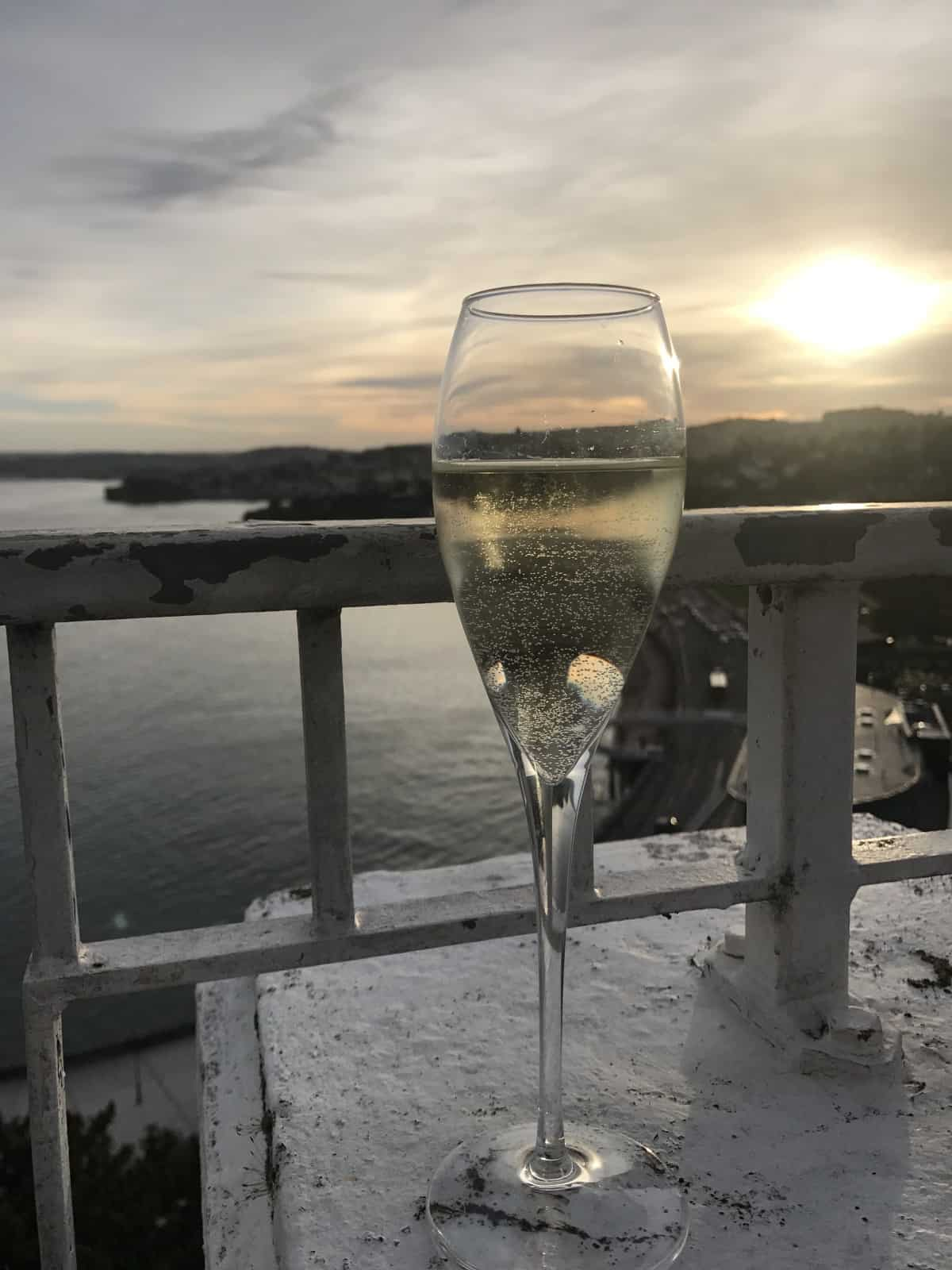 A glass of champagne on our patio - where to stay in Devon, south of England