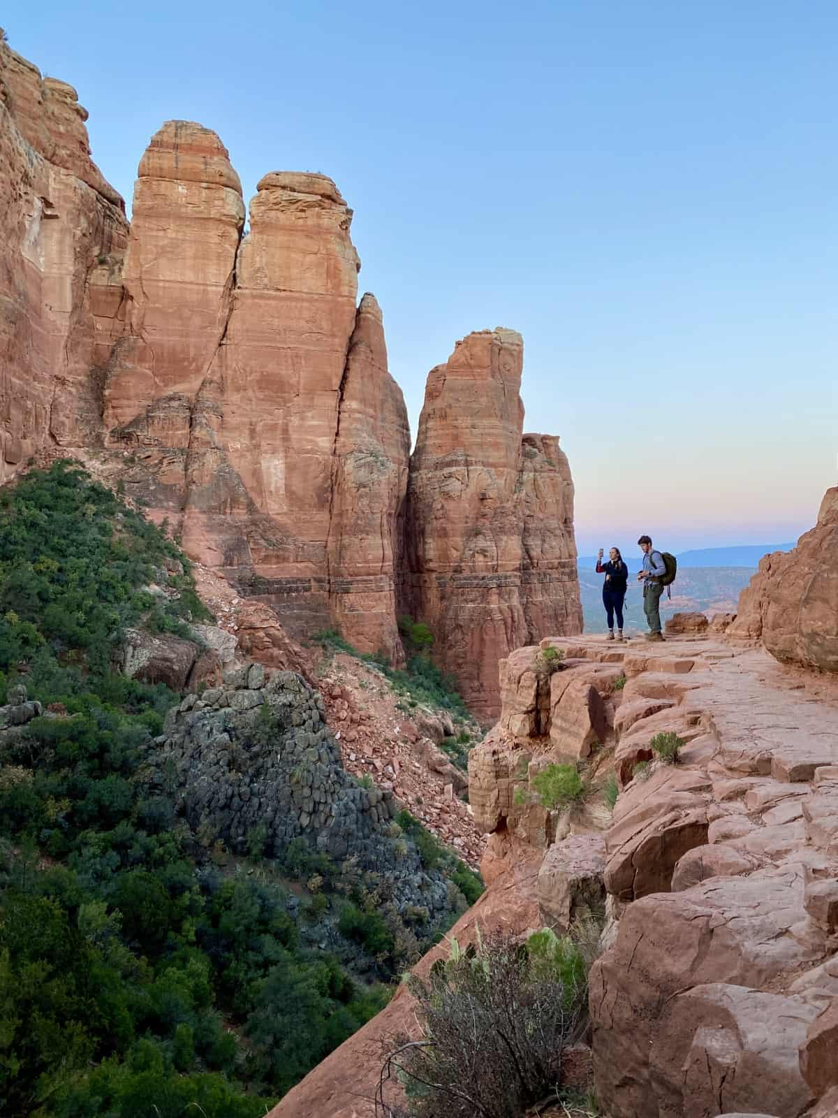 What It's Like Hiking Sedona's Cathedral Rock at Sunrise | This iconic & challenging hike is stunning any time of day, but sunrise is a particularly magical experience. How to determine if Cathedral Rock Sedona is the right hike for you (heights, steepness, etc), & tips for making the most of it. #cathedralrock #sedona #hiking #sunrisehike