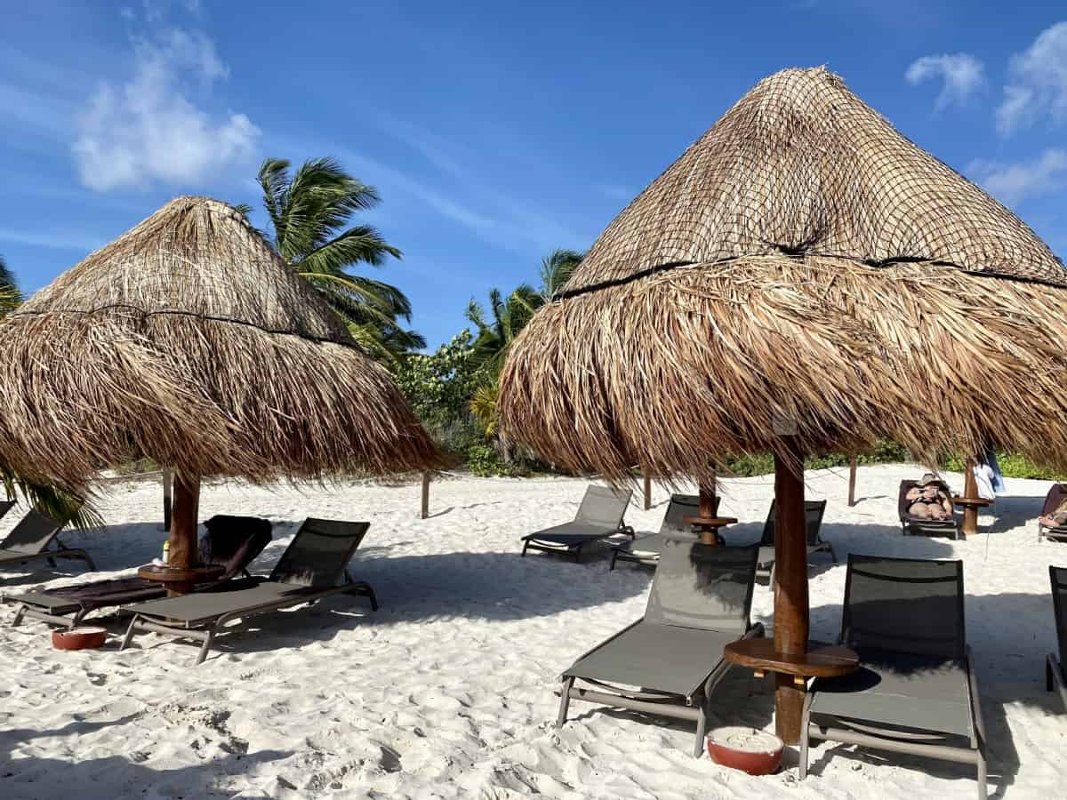 Beach chairs and palapas at Excellence Playa Mujeres