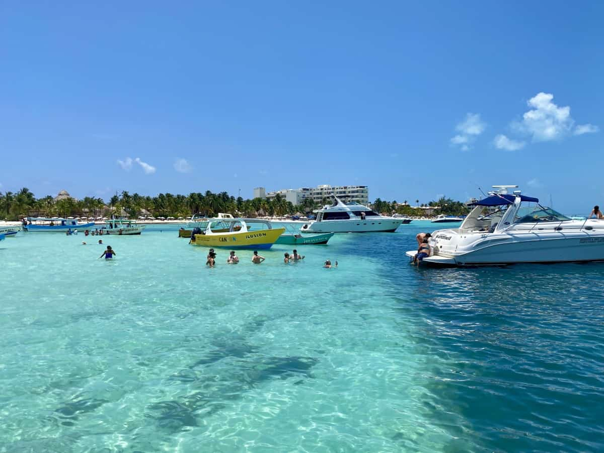 Boats partying off Isla Mujeres, an excursion from Excellence Playa Mujeres