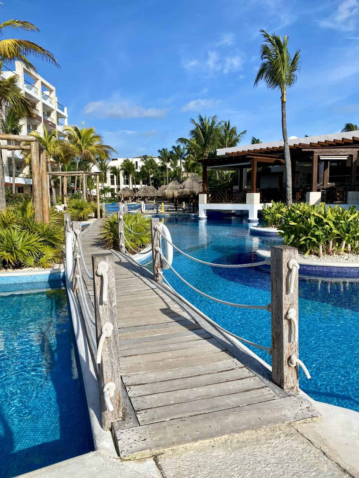 A Detailed Honest Review of Cancun's Excellence Playa Mujeres Resort   After staying 5 days I wanted to write a thorough Excellence Playa Mujeres review for this Cancun Mexico resort, to talk about the rooms, resort grounds, pools, beach, service, activities, & more. Includes whether Excellence Club is worth it at EPM!