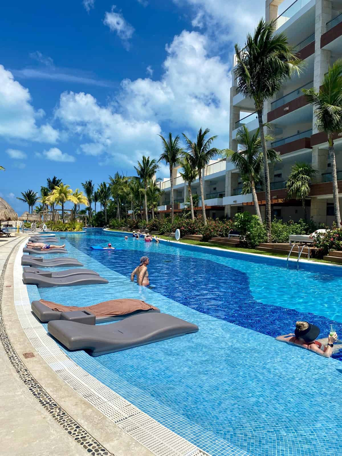 A Detailed Honest Review of Cancun's Excellence Playa Mujeres Resort   After staying 5 days I wanted to write a thorough Excellence Playa Mujeres review for this Cancun Mexico resort, to talk about the rooms, resort grounds, pools, beach, service, activities, & more. Includes whether Excellence Club is worth it at EPM! #resortreview #cancun #mexico #excellenceplayamujeres #luxury