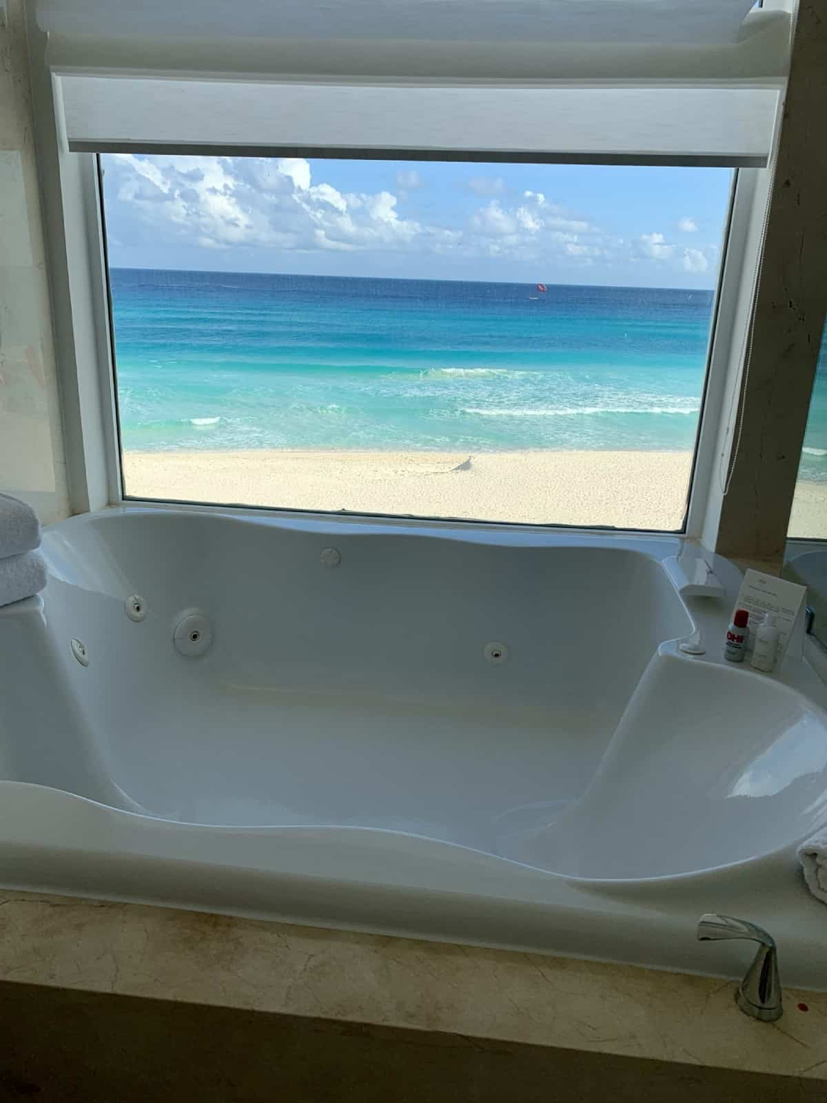 Detailed review of LeBlanc Cancun vs. Excellence Playa Mujeres - a bathtub with a view