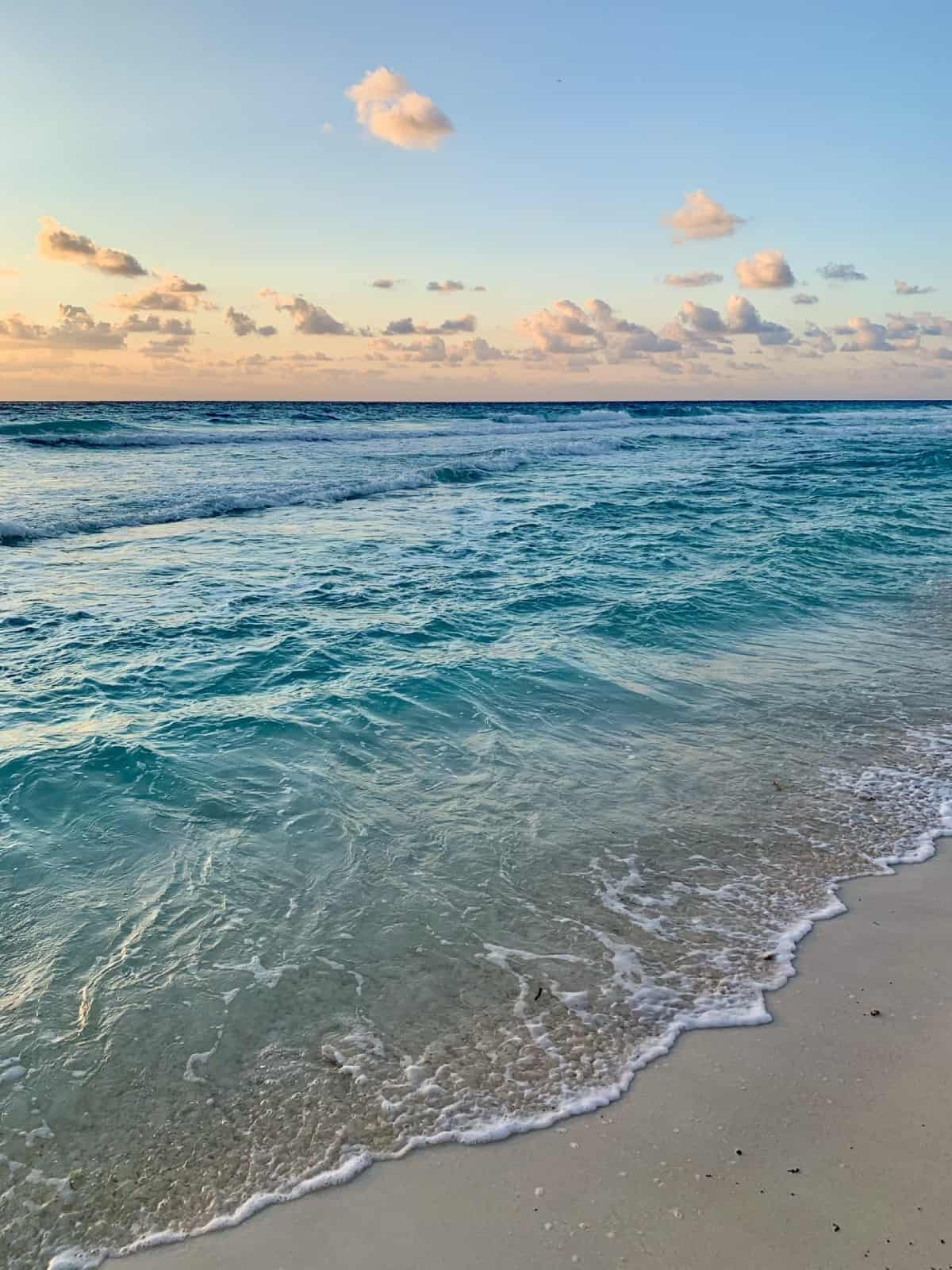 Detailed review of LeBlanc Cancun vs. Excellence Playa Mujeres - sunrise on the beach is gorgeous at both resorts